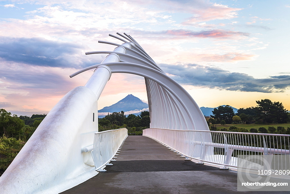 Te Rewa Rewa Bridge at sunset with Mount Taranaki (Mount Egmont) behind, Taranaki Region, North Island, New Zealand, Pacific