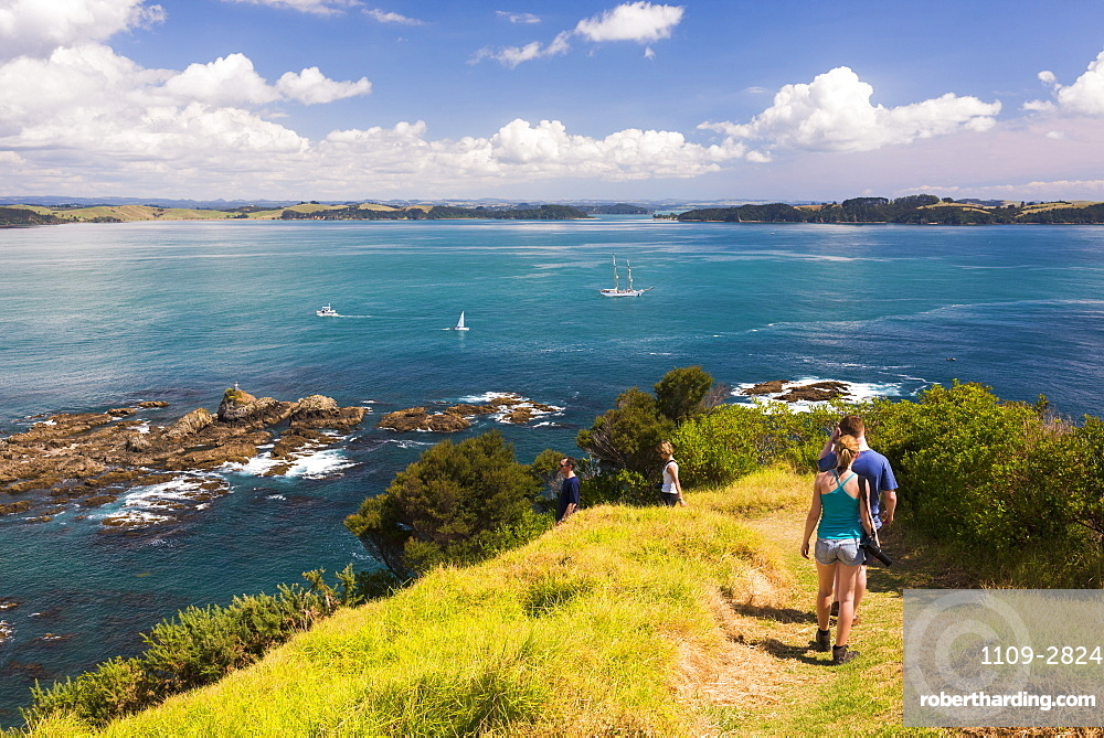 Family walking on Tapeka Point, Russell, Northland Region, North Island, New Zealand, Pacific