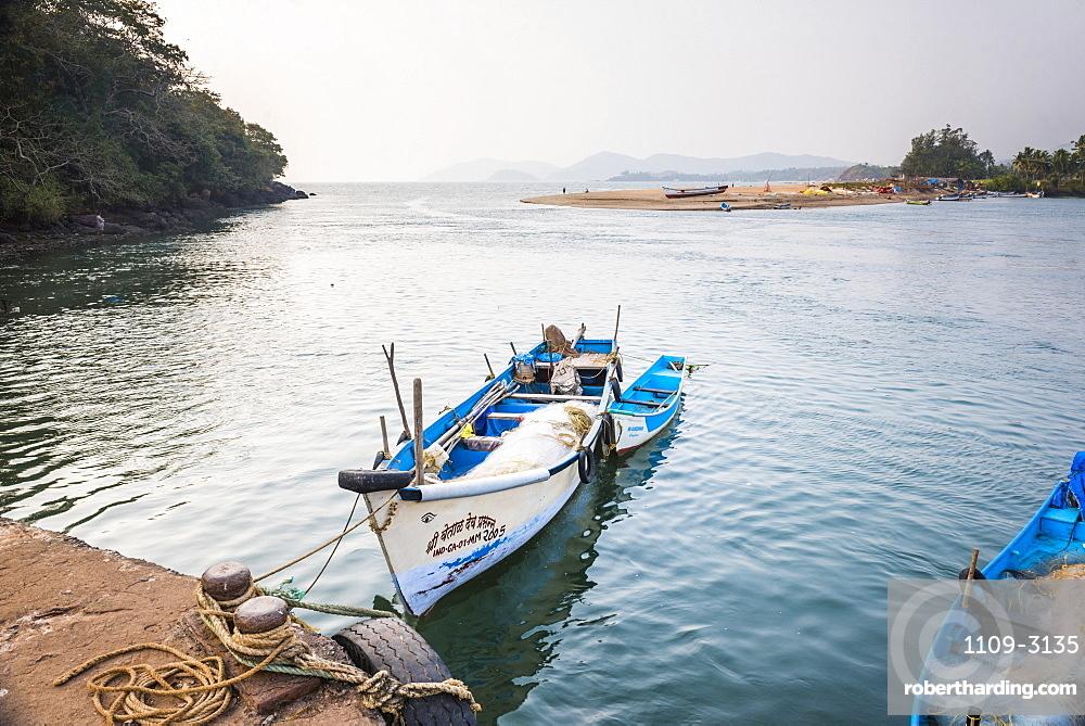 Fishing boats in a port at Talpona Beach, South Goa, India, Asia