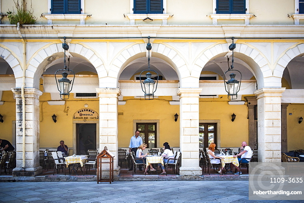 People dining under arches at restaurant in old town of Corfu, Corfu Island, Ionian Islands, Greece, Europe