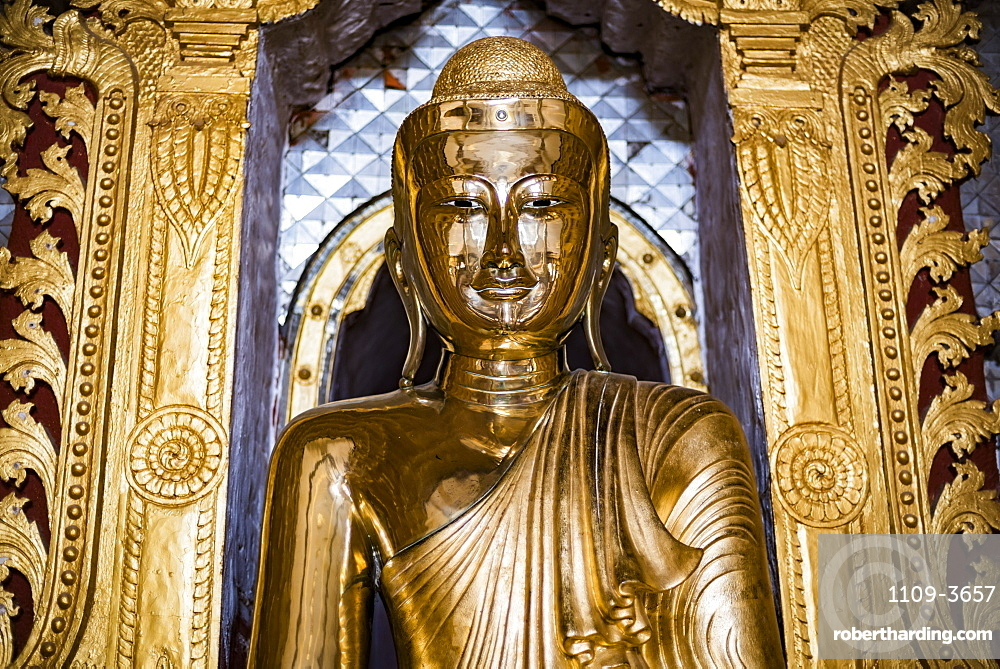 Gold Buddha statue at a Buddhist Temple at Inle Lake, Shan State, Myanmar (Burma)
