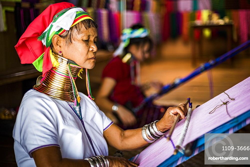 Long necked woman from Padaung tribe weaving at Inle Lake, Shan State, Myanmar (Burma), Asia