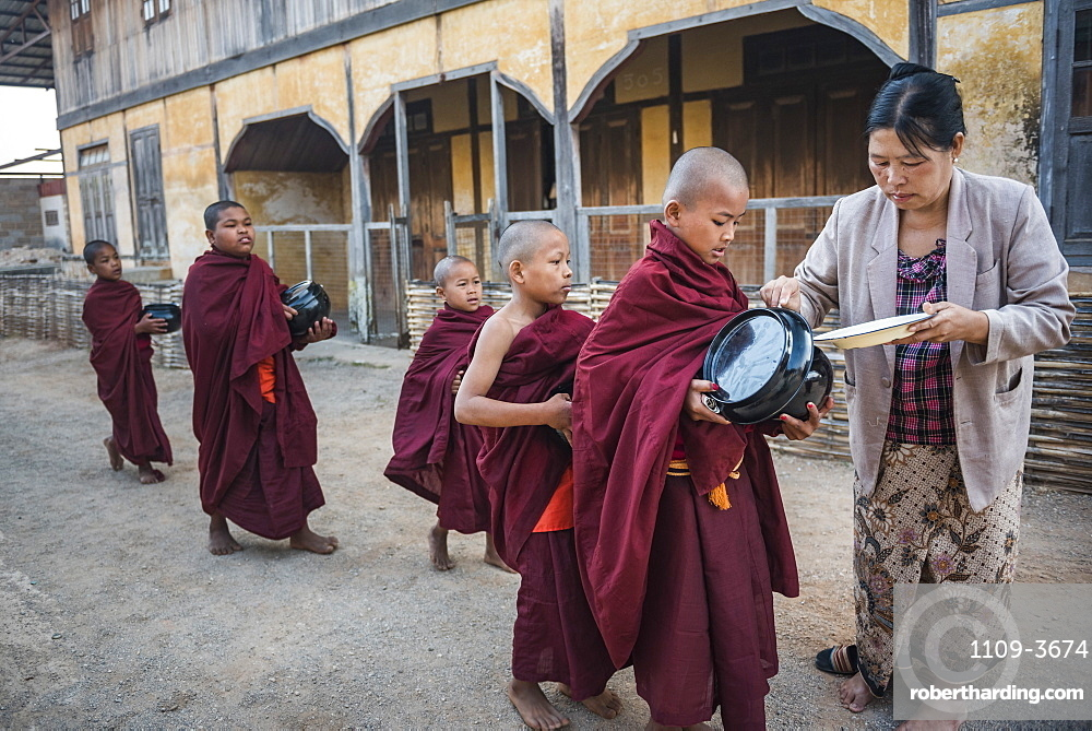 Young novice monks collecting alms at Pindaya, Shan State, Myanmar (Burma), Asia