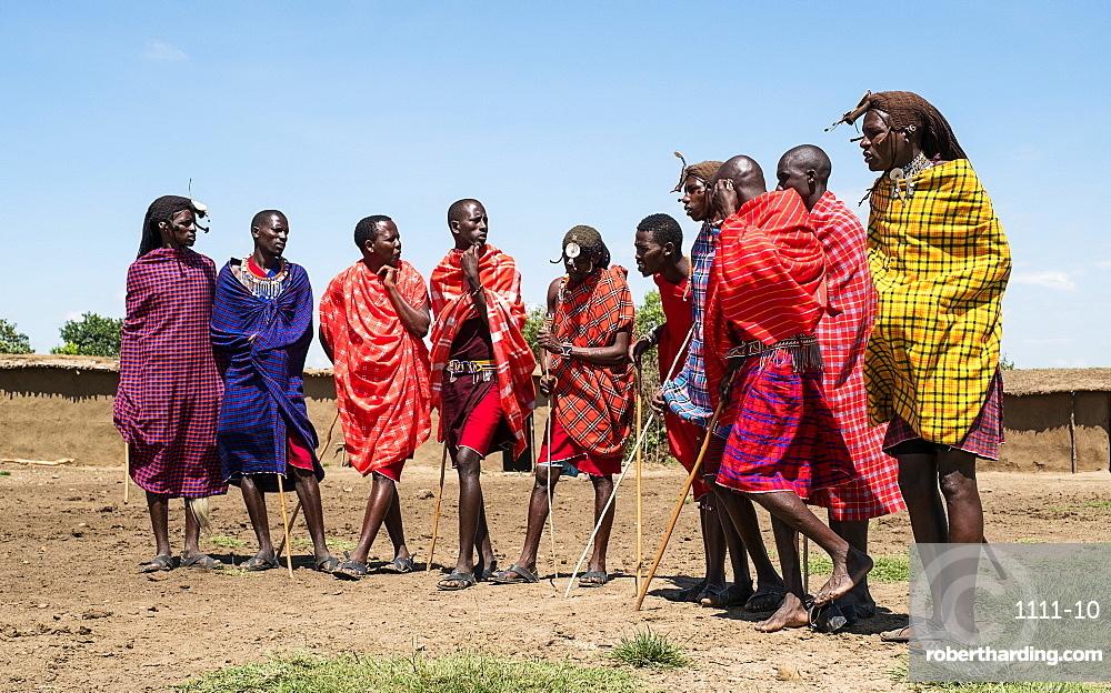 Masai Mara members sing tribal songs to greet guests to their village, Masai Mara National Reserve, Kenya, East Africa, Africa