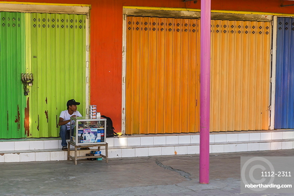 Man selling electronics from small cart in the capital city of Dili, East Timor, Southeast Asia, Asia