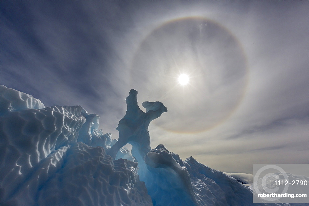 Complete sun halo and glacial iceberg detail at Cuverville Island, Antarctica, Polar Regions