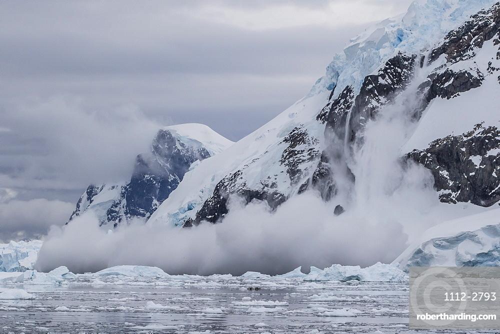 Falling avalanche of snow and ice in Neko Harbor, Antarctica, Polar Regions