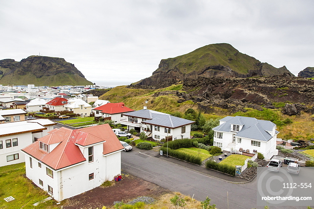 View over the town of Heimaey from recent lava flow on Heimaey Island, Iceland, Polar Regions