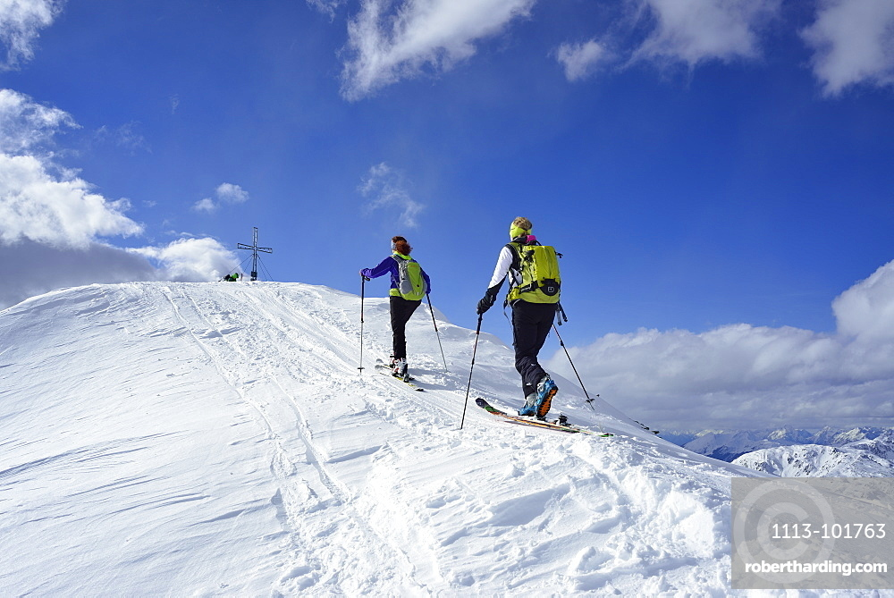 Two female back-country skiers ascending to Schafsiedel, Kitzbuehel Alps, Tyrol, Austria