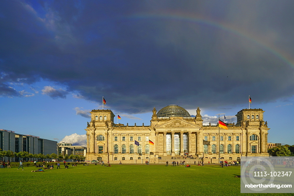 Rainbow and storm clouds above the Reichstag building, Berlin, Germany