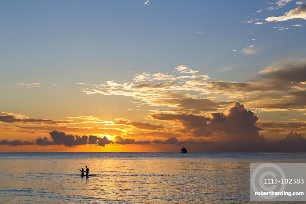 People bathing in the water at Meeru Island Resort, Meerufenfushi, North-Male-Atoll, Maldives