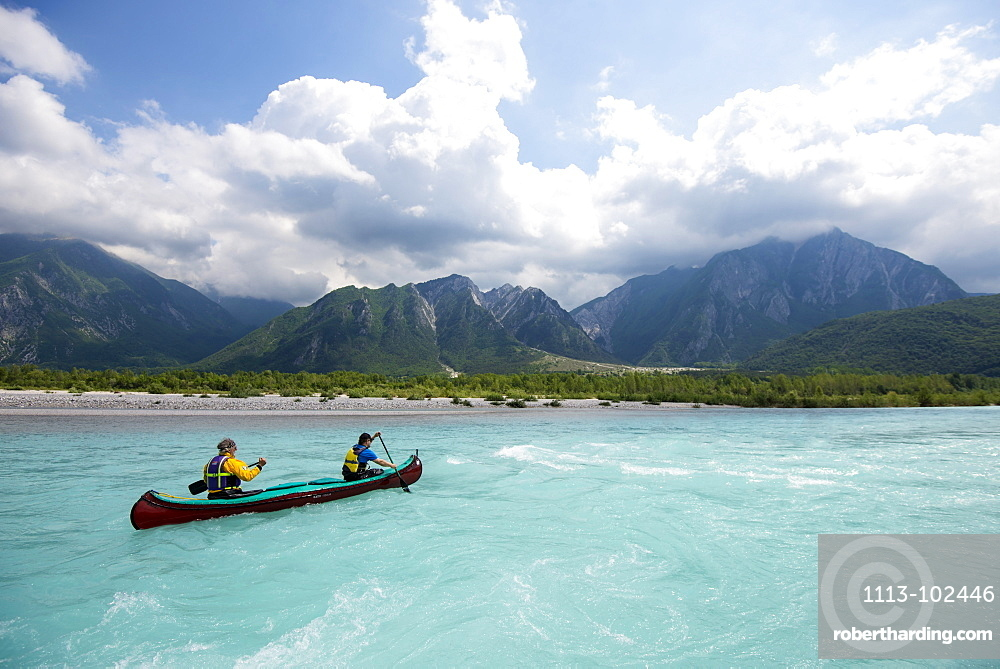 Canoeing on the blue waters of the Talgliamento, Tolmezzo, Italy