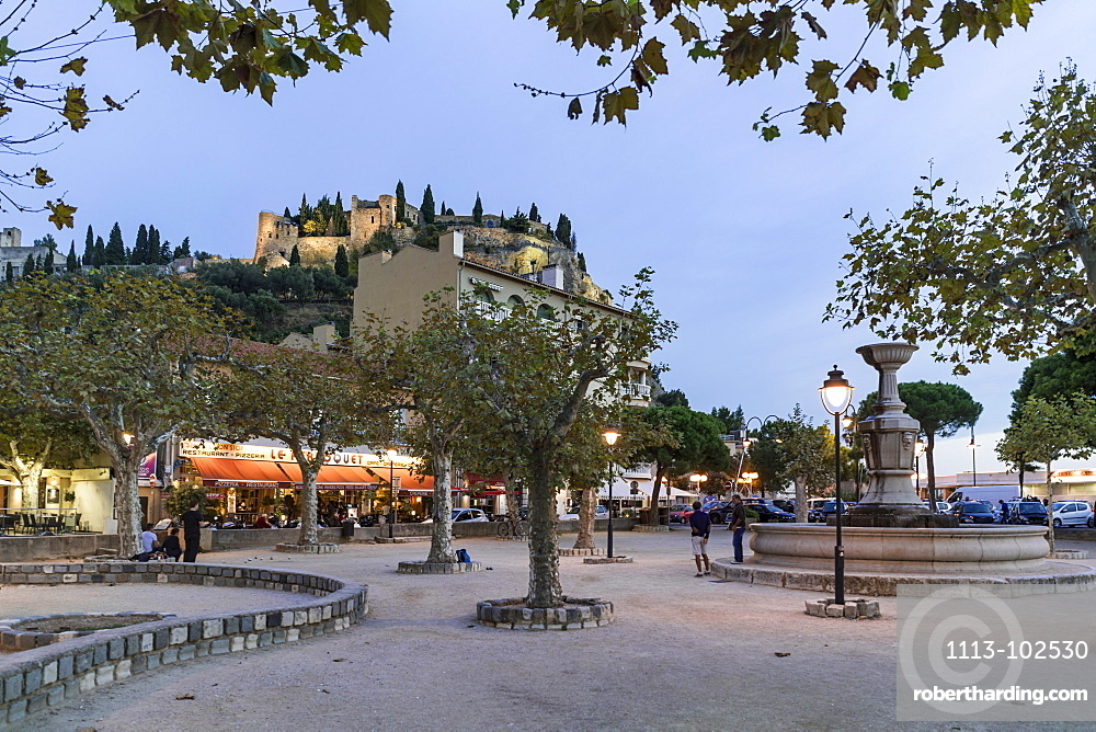 Boules in a square near the harbour, Fortress in the background, Cassis, Cote d Azur, France