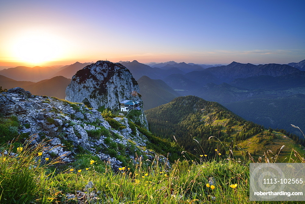 Sunrise above Buchstein with hut Tegernseer Huette, Mangfall Mountain Range, Upper Bavaria, Bavaria, Germany