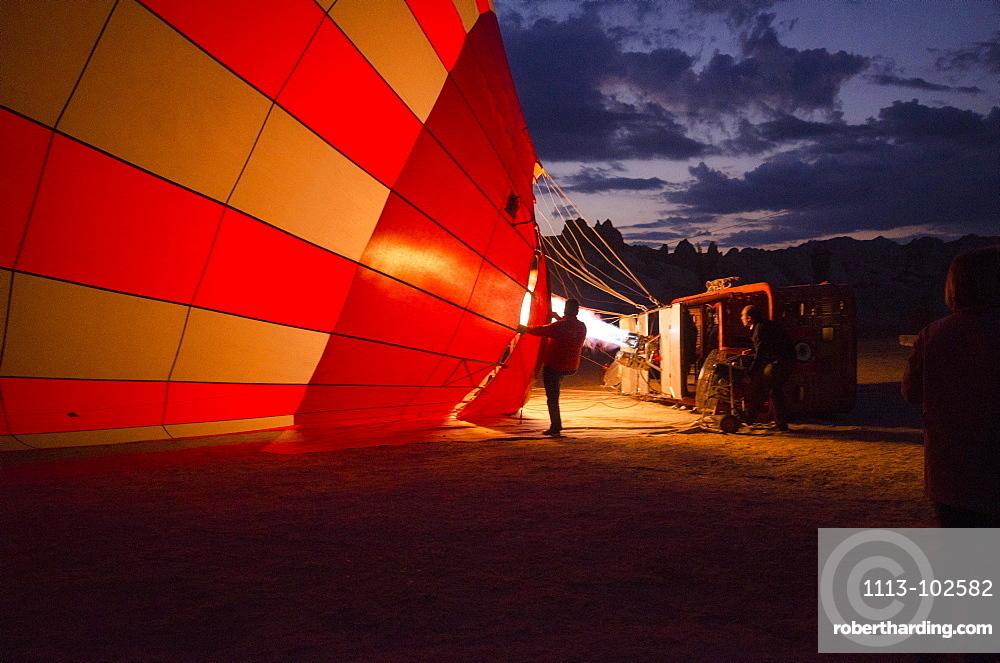 Balloon pilots at the break of dawn in Goereme, Cappadocia, Turkey