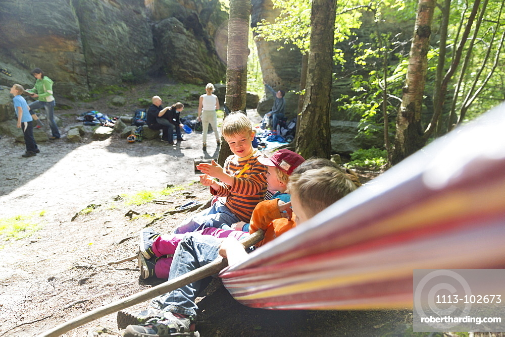 Children waiting in a hammock, climbing area, Saxony Switzerland, Hercules' Pillars, women, Elbe sandstone mountains, Dresden, Saxony, Germany, Europe