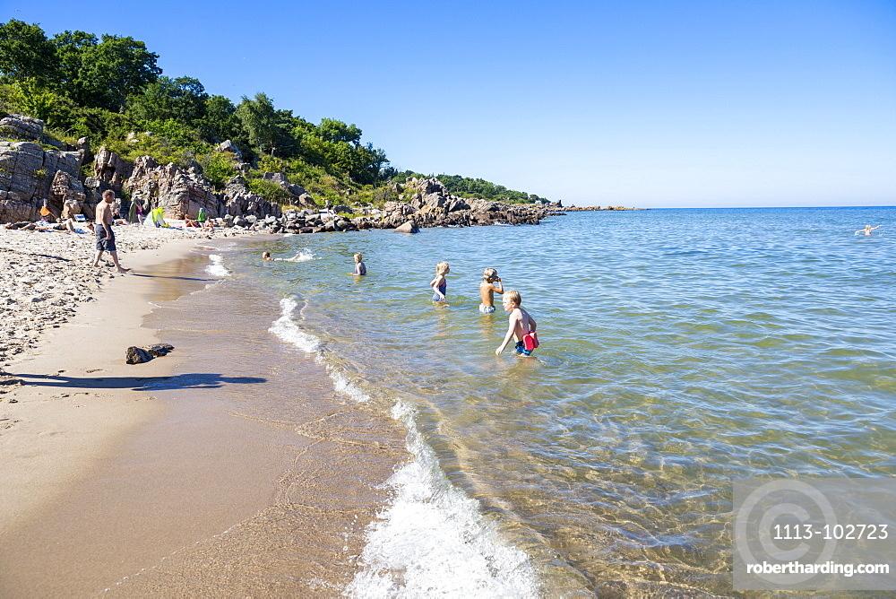 Family bathing in the sea, Sandkas beach, Summer, Holiday, Baltic sea, Bornholm, south of Sandvig and Allinge, east coast, Denmark, Europe