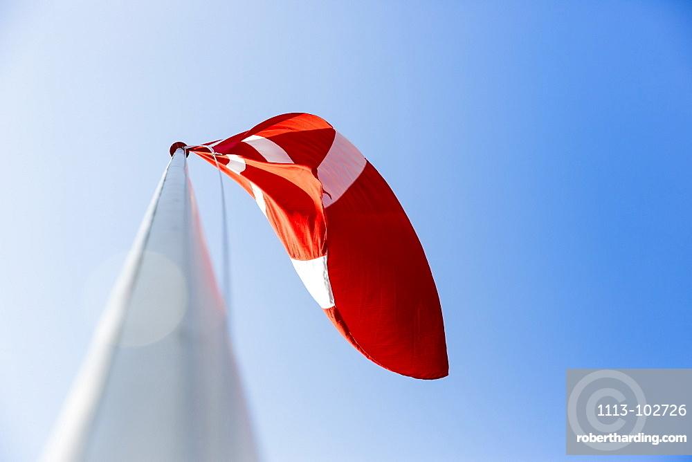 danish flag blowing in the wind, Baltic sea, Bornholm, near Gudhjem, Denmark, Europe