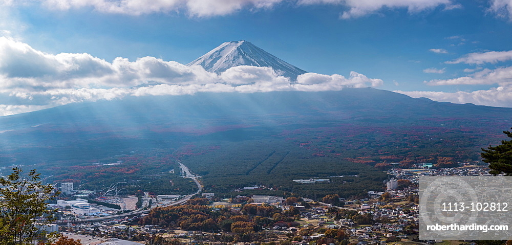 Mt. Fuji with clouds and sunrays in autumn seen from Mt. Kachi, Minamitsuru, Yamanashi Prefecture, Japan