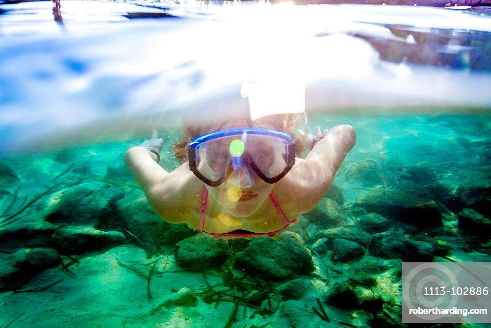 nine yeares old girl swimming with the mask, Cala s'Almunia, Mallorca, Balearic Islands, Spain
