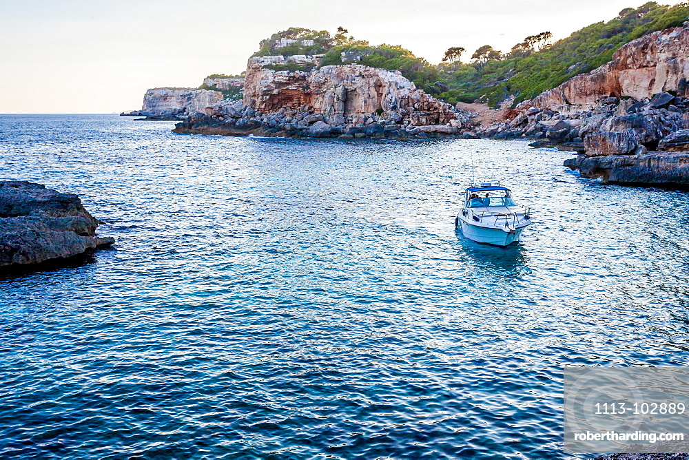 Motorboat next to the Cala s'Almunia beach, Mallorca, Balearic Islands, Spain