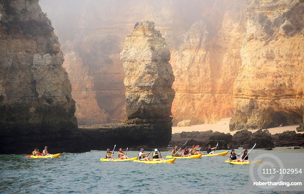 Canoeists near Ponta Piedade near Lagos, Algarve, Portugal