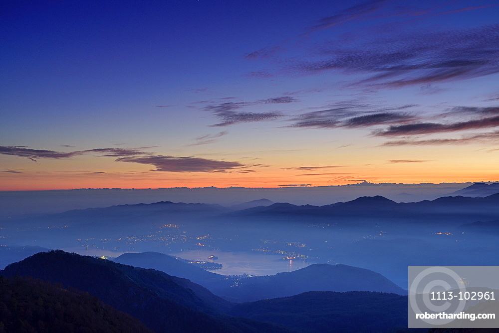 View to lake Lago d'Orta and Cottian Alps in the background, view from Mottarone, Piedmont, Italy