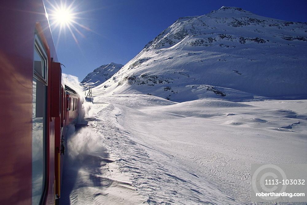 Rhaetian Railway in winter, Engadin, Canton of Grisons, Switzerland