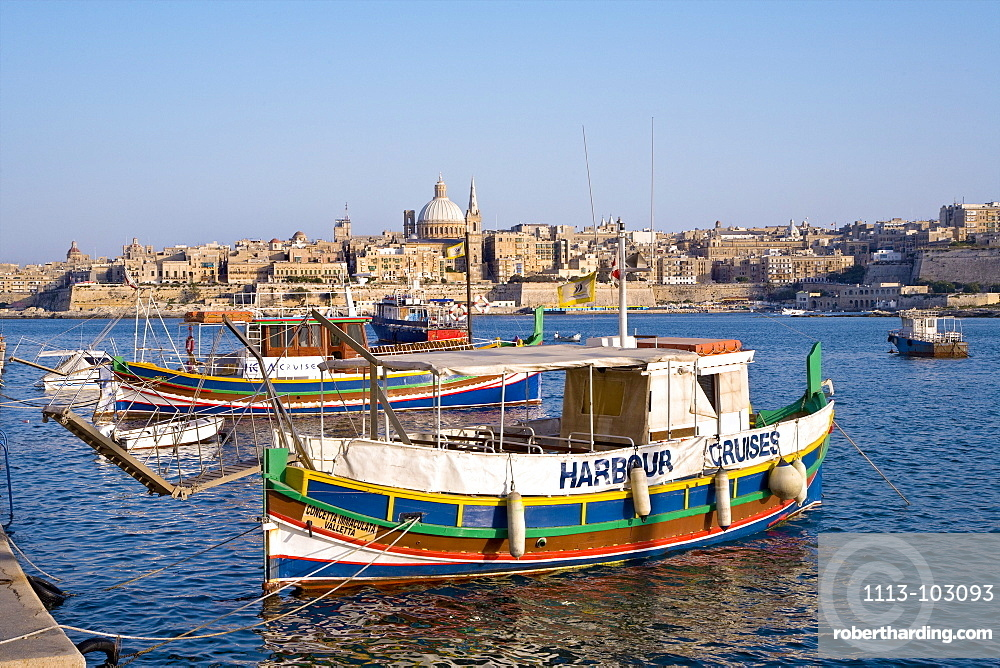 Colourful excursion boat at Marsamxett Harbour with view at the town Valletta, Sliema, Malta, Europe