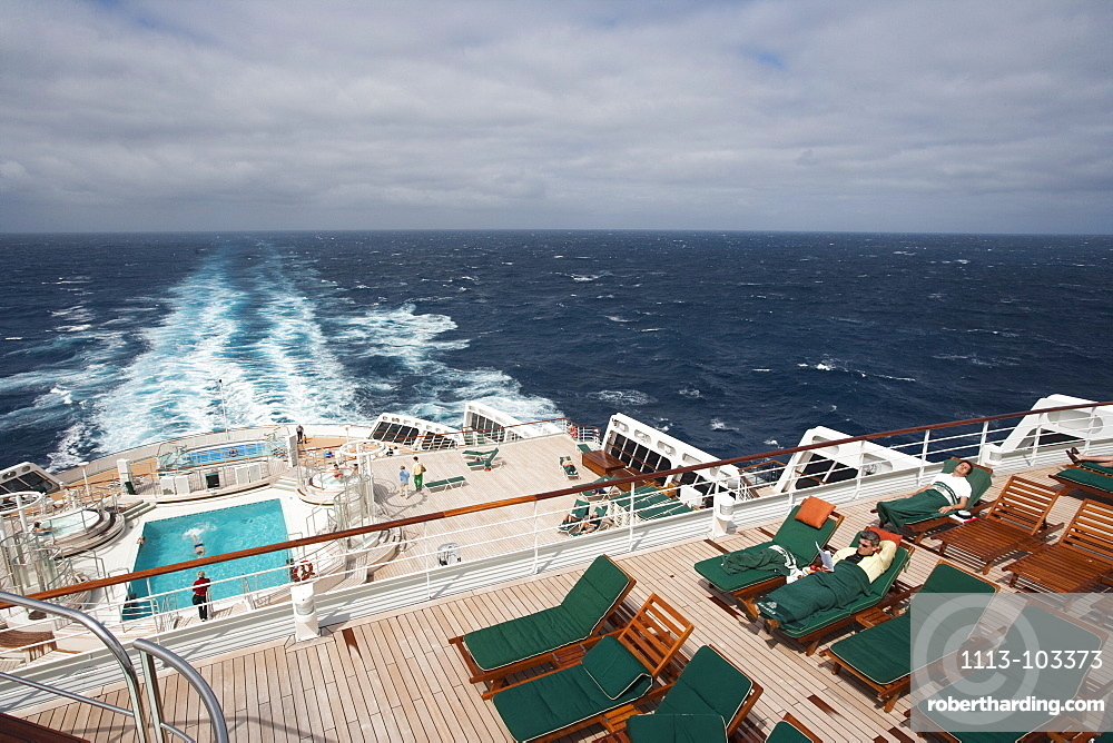 Deck chairs, swimming pool and backwash, cruise ship Queen Mary 2, Atlantic ocean