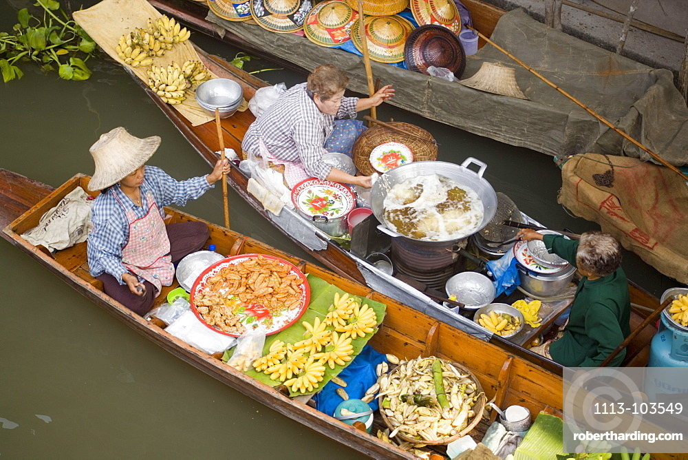 Top view of two boats at the Floating Market, Damnoen Saduak, near Bangkok, Ratchaburi, Thailand