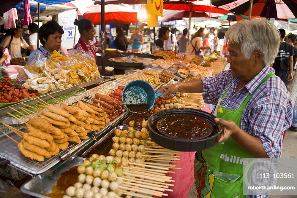 Woman preparing Thai food at Suan Chatuchak Weekend Market, Bangkok, Thailand