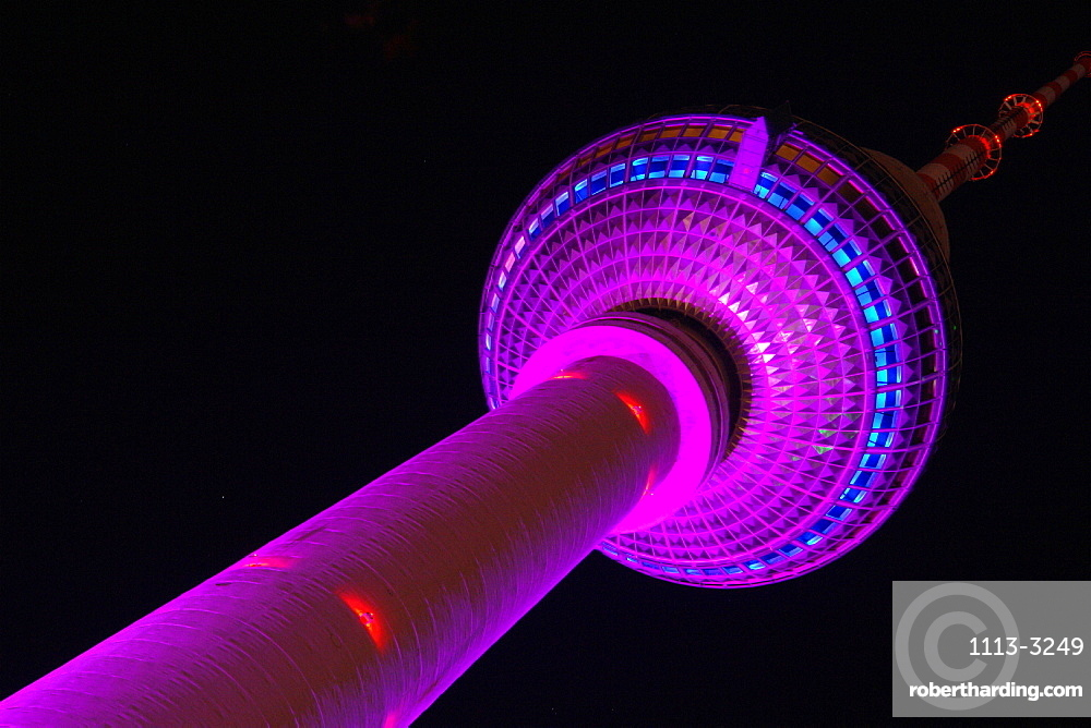 Illuminated Television Tower at night, View from foot of the tower, Berlin, Germany