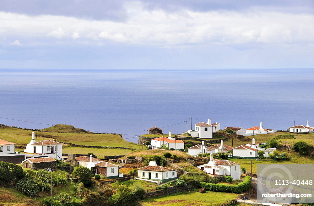 Houses at the south coast under clouded sky, Island of Santa Maria, Azores, Portugal, Europe