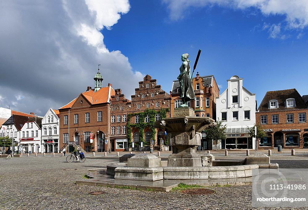 Market square with Rasmussen Woldsen Fountain, Husum, Schleswig-Holstein, Germany