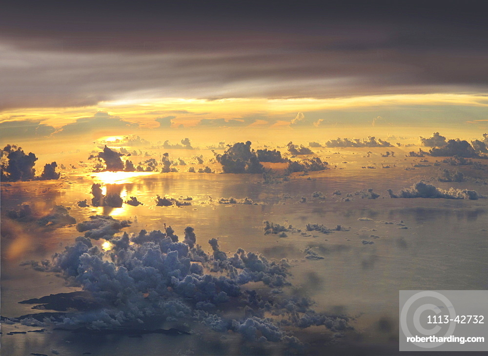 View from a plane over the sea of clouds on archipelagoes