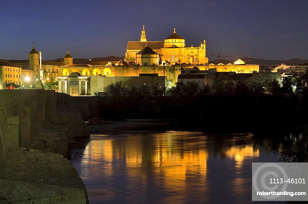 Illuminated cathedral La Mezquita, roman bridge and the river Guadalquivir in the evening, Cordoba, Andalusia, Spain, Europe