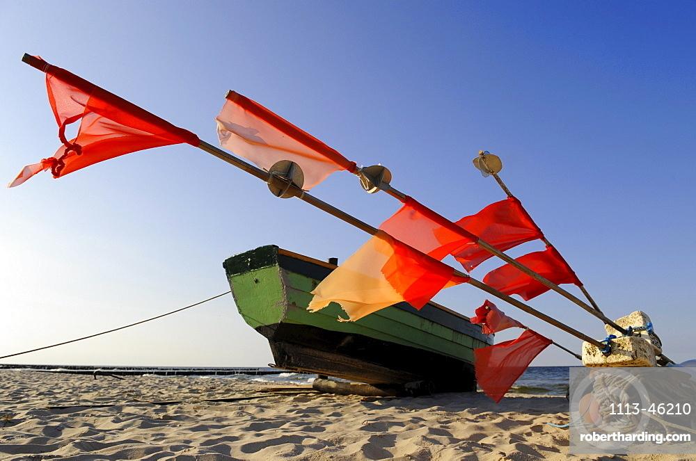 Fishing boat on the beach in the sunlight, Stubbenfelde, Usedom, Mecklenburg-Western Pomerania, Germany, Europe