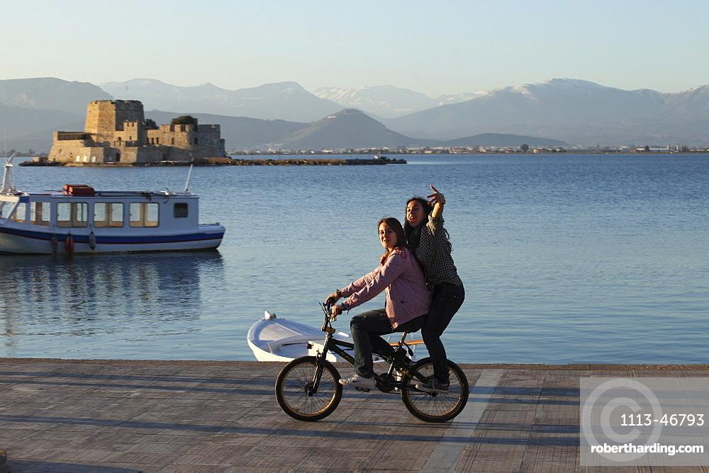 two young girls on bike, Nauplia, Peloponnes, Greece