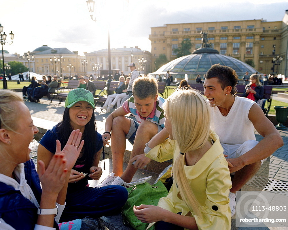 Teenage friends meeting up at Manege square, Moscow, Russia, Europe