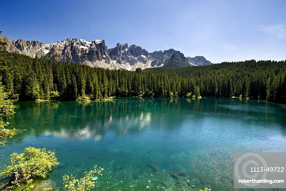 Lake Karersee in the sunlight in front of Dolomites, Nature reserve Schlern Rosengarten, Alto Adige, South Tyrol, Italy, Europe