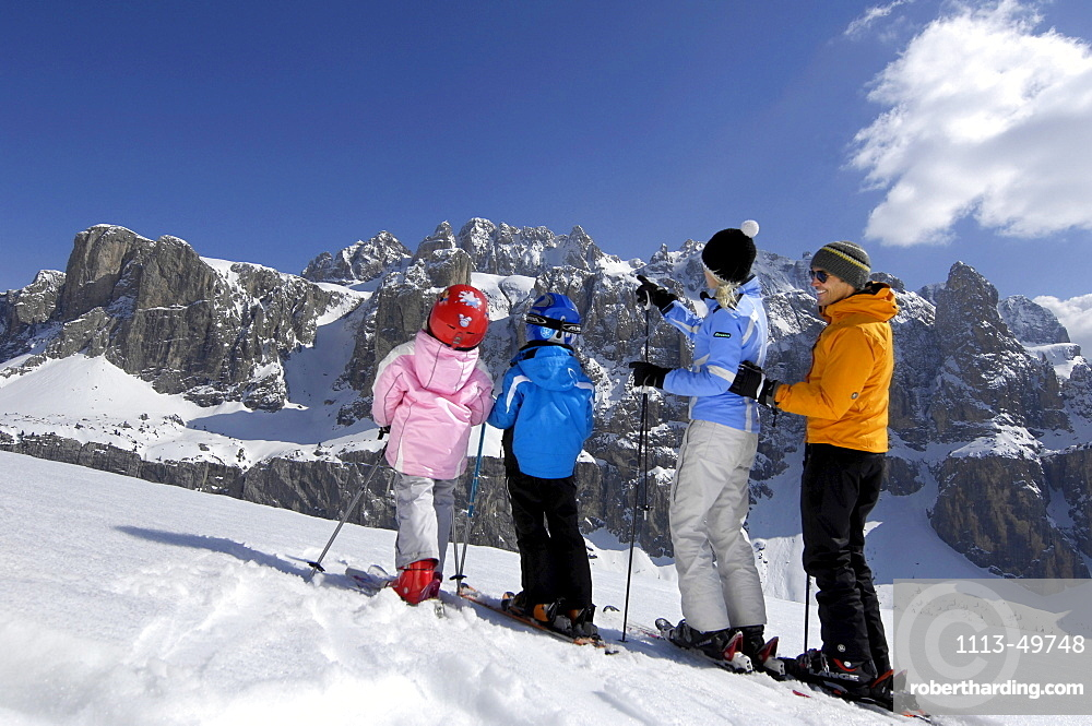 Family on skis in snowy mountain scenery, Alto Adige, South Tyrol, Italy, Europe
