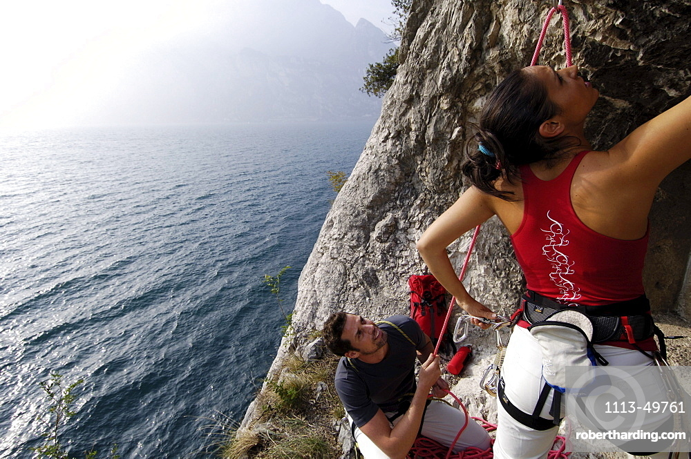 Two climbers at a rock face above lake Garda, Italy, Europe