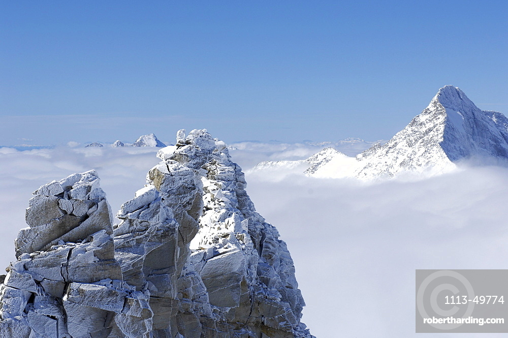 Snow covered mountains and sea of fog, Dolomites, Alto Adige, South Tyrol, Italy, Europe