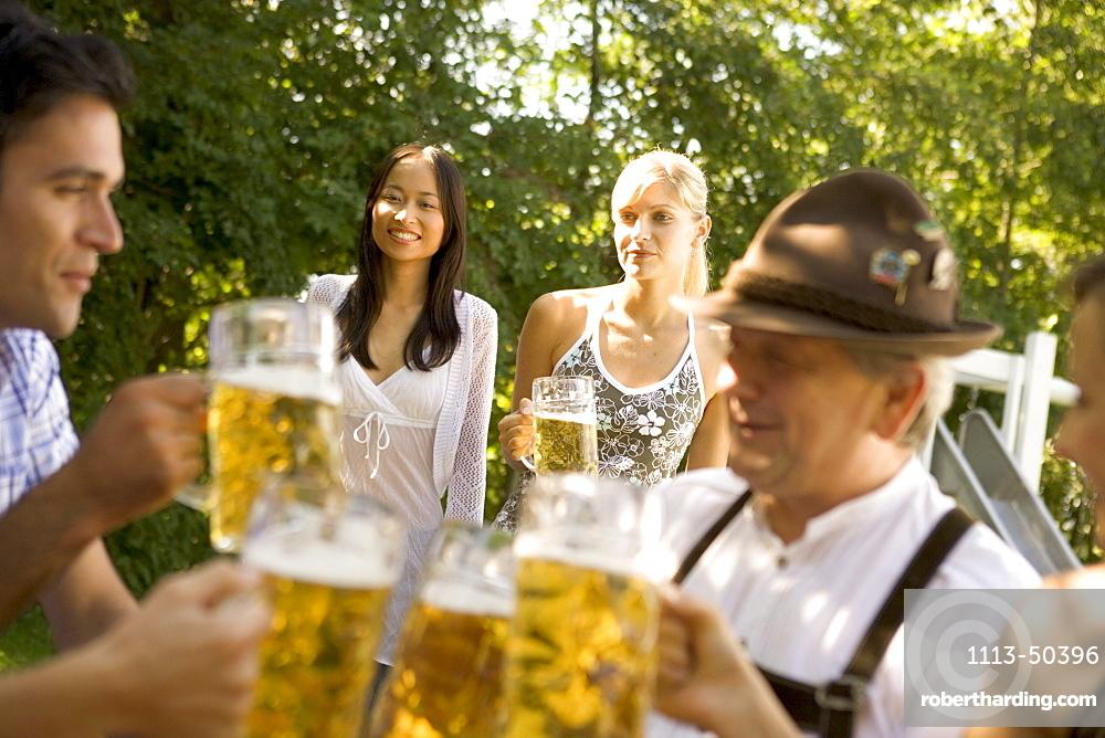 Friends in beergarden near Lake Starnberg, Bavaria, Germany