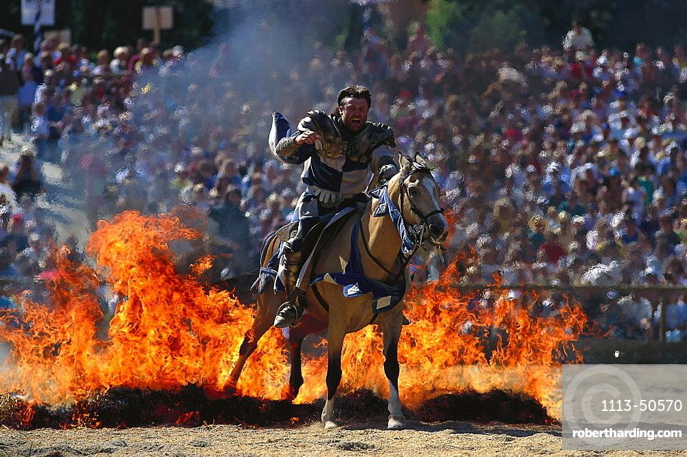 Man riding on a horse through flames, Kaltenberger knight games, Kaltenberg, Bavaria, Germany, Europe