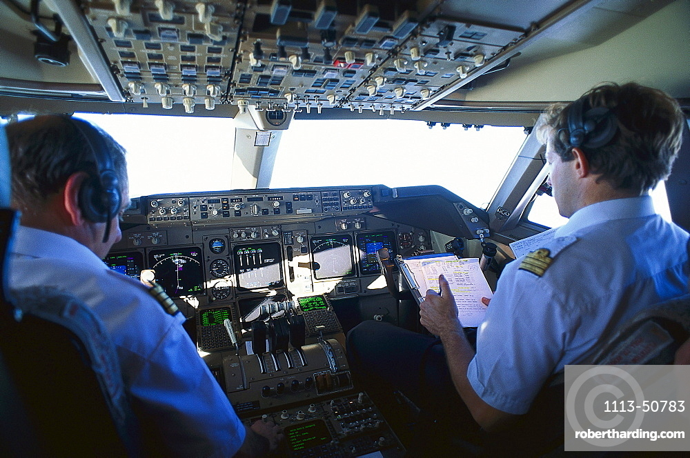 Rear view of pilot and copilot at the cockpit of a Boing 747 of Air France
