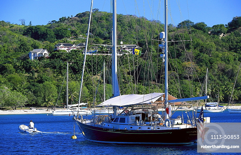 Sailing boat at Britania Bay off Mustique island, St. Vincent, Grenadines, Caribbean, America