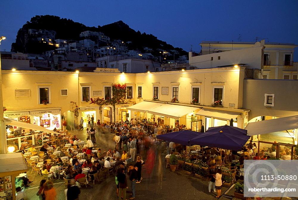 People sitting in restaurants at Piazetta Umberto I. in the evening, Capri, Italy