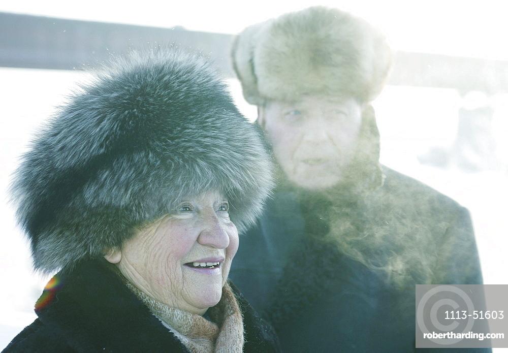 Old couple wearing fur hats, Omsk, Siberia